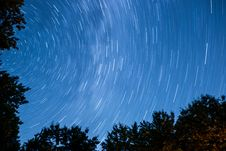 Free Time Lapse Photo Of Blue Skies Full Of Stars Above Silhouette Of Trees Stock Image - 84933701