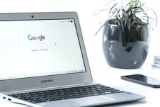 Free Grey Samsung Laptop Turned On Beside Black Smartphone Stock Photo - 84933740