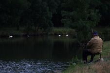Free Man Sitting On Chair Fishing Beside The River During Daytime Royalty Free Stock Images - 84934109