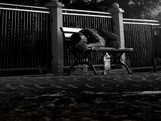 Free Man Asleep On Park Bench Stock Images - 84934154