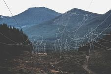 Free Electricity Pylons And Mountains Royalty Free Stock Images - 84934299