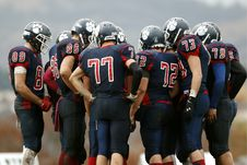 Free Huddle Of American Football Players Royalty Free Stock Image - 84934536