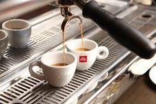 Free Cups Of Espresso Below Espresso Machine Royalty Free Stock Image - 84934696