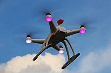 Free Quadcopter Drone In Flight Royalty Free Stock Photography - 84934897