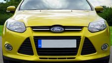Free Yellow Ford Motor Car Royalty Free Stock Image - 84934936