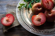 Free Sliced Plums On Silver Round Platter Stock Images - 84935754