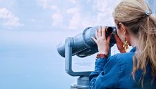 Free Woman In Blue Denim Jacket Holding A Gray Steel Tower Viewer Stock Images - 84935814