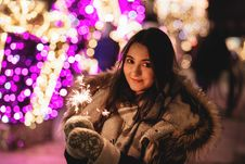 Free Woman Holding Sparkler Royalty Free Stock Images - 84935909