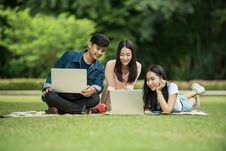 Free Teenagers With Laptops On Grass Stock Photos - 84936213