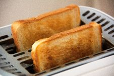 Free Toasted Bread On Bread Toaster Royalty Free Stock Photos - 84936528