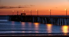 Free Wooden Dock On Sea Shore With Light Post During Sunset Stock Photos - 84936673