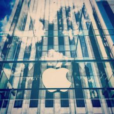 Free Clear Glass Apple Building Uncer Clouded Blue Sky Stock Images - 84936824