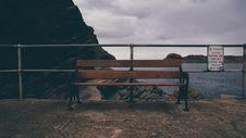 Free Black Metal Frame Brown Wooden Bench Beside Black Metal Fence During Twilight Royalty Free Stock Photos - 84938388