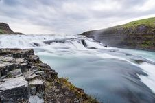 Free White And Blue Waterfalls Near Green And Gray Rocks Under The Cloudy Sky Stock Photos - 84938443