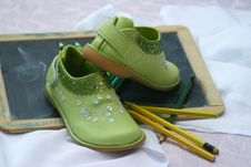 Free Green Slip On Shoes Near Yellow And Green Pencil Stock Photo - 84939240