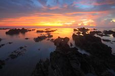Free Rocky Beach At Dusk Stock Image - 84940141