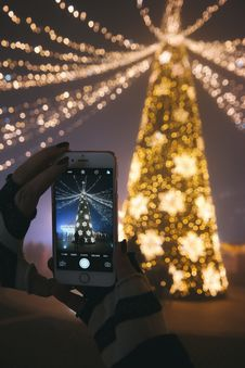 Free Person Photographing Christmas Tree Stock Photos - 84943923