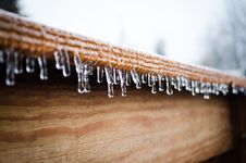 Free Icicles Hanging From A Wooden Roof Stock Images - 84944404