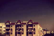 Free Apartment Building With Balconies At Dusk Stock Photography - 84951102