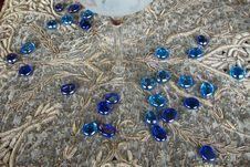 Free Blue Glass Pebbles On Lace Royalty Free Stock Images - 84953949