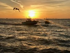 Free Boat On Waters At Sunset Royalty Free Stock Photos - 84955528