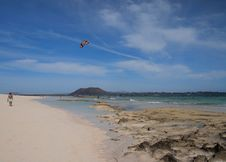 Free Flying Kite Above Sandy Beach Stock Photography - 84956952