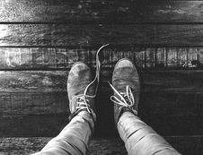Free Man Wearing Low Top Shoes Standing On Wooden Plank In Grayscale Photo Stock Photography - 84958342