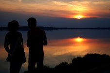 Free Silhouette Of Man And Woman Near Water During Sun Set Royalty Free Stock Photo - 84958465