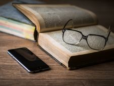Free Space Grey Iphone 6 Near Book And Black Framed Eyeglasses Stock Photos - 84958553