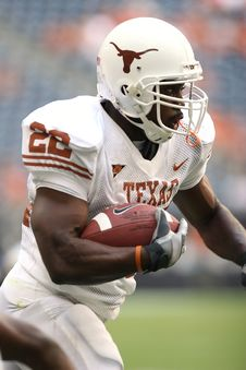 Free Man Wearing Texas Nike 22 Jersey Holding Ball And Running During Daytime Royalty Free Stock Images - 84958899
