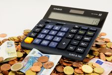 Free Calculator On Pile Of Euros Royalty Free Stock Photography - 84958977