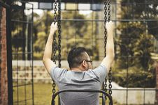 Free Man Sitting On Swing Stock Photo - 84959840
