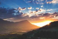 Free Sunset Behind Mountains Royalty Free Stock Image - 84960316