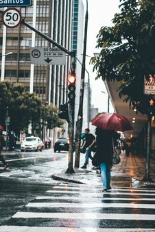 Free People Walking On Rainy City Sidewalk Stock Photography - 84960492