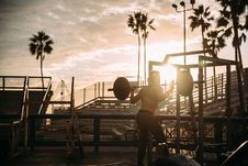 Free Bodybuilder Exercising At Sunset Stock Photography - 84960562