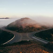 Free Roads Passing Hills Royalty Free Stock Images - 84961009