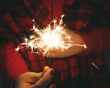 Free Woman Holding Sparkler Stock Photography - 84961312