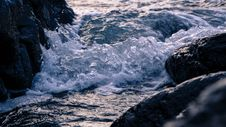 Free Waves Hitting Rocks Stock Photos - 84961693
