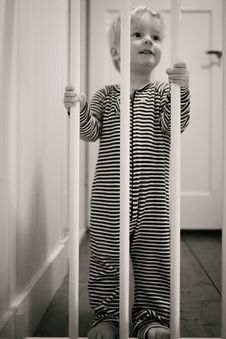 Free Boy Behind Bars Royalty Free Stock Photography - 84961877