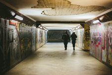 Free People Walking On Subway With Lights Turned On Royalty Free Stock Photo - 84963155
