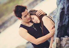 Free Man Hugging A Woman Wearing Black Tank Top Royalty Free Stock Images - 84964119