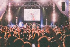 Free Projector Canvas Over People Performing On Stage In Front Of Crowd Raising Their Hands Stock Image - 84966491