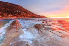 Free Waves On Rocks On Shore At Sunset Royalty Free Stock Photography - 84967997