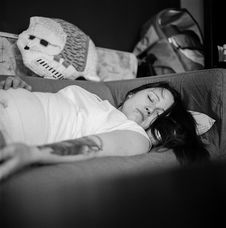 Free Woman In White Shirt Sleeping On Gray Fabric Sofa Stock Photos - 84968393