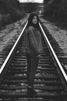 Free Woman In Denim Jacket On Train Railway Gray Scale Photo Stock Image - 84970081