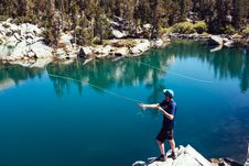 Free Man In Blue T Shirt Fishing On Lake During Day Time Royalty Free Stock Photography - 84991607