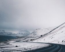 Free Grey Asphalt Road Near White Snow Mountain Royalty Free Stock Image - 84994916