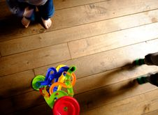 Free Toy And Children S Feet On Floor Royalty Free Stock Photos - 84996638