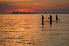 Free Fishermen Silhouettes On Vibrant Tropical Sunset Beach Stock Images - 857464