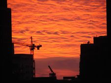 Free Construction Cranes Against A Fiery Sunset Stock Image - 859311
